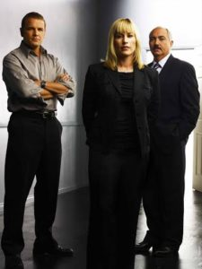 MEDIUM -- NBC Series -- Pictured: (l-r) David Cubitt as Detective Lee Scanlon, Patricia Arquette as Allison DuBois, Miguel Sandoval as D.A. Manuel Devalos -- NBC Universal Photo: Andrew EcclesFOR EDITORIAL USE ONLY -- DO NOT RE-SELL/DO NOT ARCHIVE